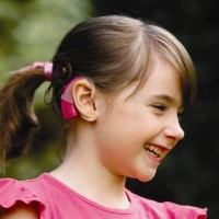 smiling_girl_cochlear_implant